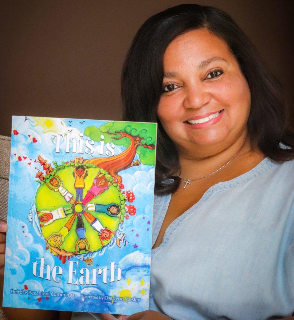 Deedee Cummings with her book